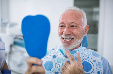 Dental Implants for Dentures in Detroit MI area - Seven Oaks Oral and Maxillofacial Surgery